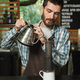 Portrait of european barista man making coffee while working in - PhotoDune Item for Sale