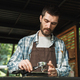 Portrait of handsome barista man making coffee while working in - PhotoDune Item for Sale