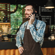 Portrait of professional barista guy talking on cellphone in str - PhotoDune Item for Sale