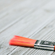 Red paint brush on grey wooden background - PhotoDune Item for Sale