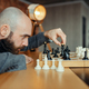 Chess player playing black figures, queen move - PhotoDune Item for Sale