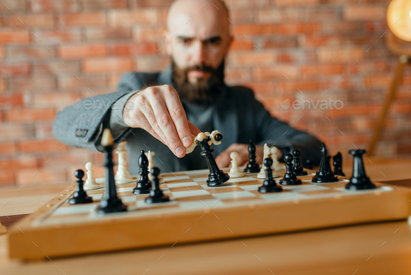 Chess player,white move, loss of the black queen - Stock Photo - Images