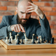 Chess player understood that he lost, checkmate - PhotoDune Item for Sale