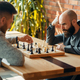 Male chess players, move the black elephant - PhotoDune Item for Sale