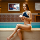 Attractive woman drinks tea at the pool indoors - PhotoDune Item for Sale