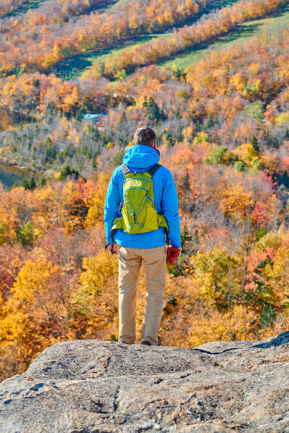 Backpacker man at Artist's Bluff in autumn - Stock Photo - Images