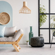 Classy living room interior with scandinavian futon sofa, pouf, armchair and urban jungle - PhotoDune Item for Sale