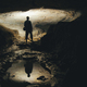 man exploring dark cave underground tunnel - PhotoDune Item for Sale