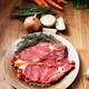 Raw beef stake with herbs and fresh vegetables ready to be grilled - PhotoDune Item for Sale