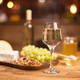 Photo of a sparkling white wine on a rustic wooden table in a vintage pub - PhotoDune Item for Sale