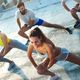 Group of happy fit young people friends in sportswear doing exercises . Sport outdoors - PhotoDune Item for Sale