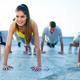 Fitness, friendship, sport and healthy lifestyle concept - group of happy friends exercising - PhotoDune Item for Sale