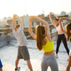 Group of young happy people friends exercising outdoors at sunset - PhotoDune Item for Sale