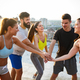 Group of fit happy sporty people exercising outdoors - PhotoDune Item for Sale