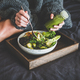 Healthy vegan bowl on tray and woman eating - PhotoDune Item for Sale
