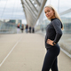 Sporty Woman in Black Workout Outfit Standing At Modern Bridge In City - PhotoDune Item for Sale