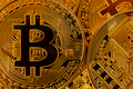 Top view closeup photo of gold bitcoins in a pile - PhotoDune Item for Sale
