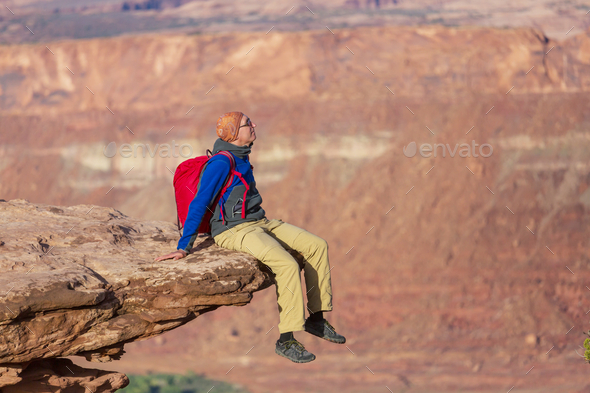 Man on the cliff - Stock Photo - Images