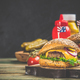 Homemade hamburgers on wooden background, space for text - PhotoDune Item for Sale