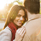 Image of young beautiful woman hugging her boyfriend and smiling in park - PhotoDune Item for Sale