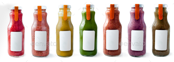 Set with color smothies in glass bottles with copy space on white background, mock-up - Stock Photo - Images