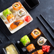 Various delicious sushi and rolls set on slate , sauce on dark stone background , flat lay - PhotoDune Item for Sale