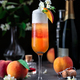 Layered bellini cocktail with peaches on dark background - PhotoDune Item for Sale