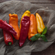 Red, yellow and orange peppers on linen background, copy space - PhotoDune Item for Sale