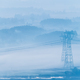 power transmission towers in morning fog - PhotoDune Item for Sale