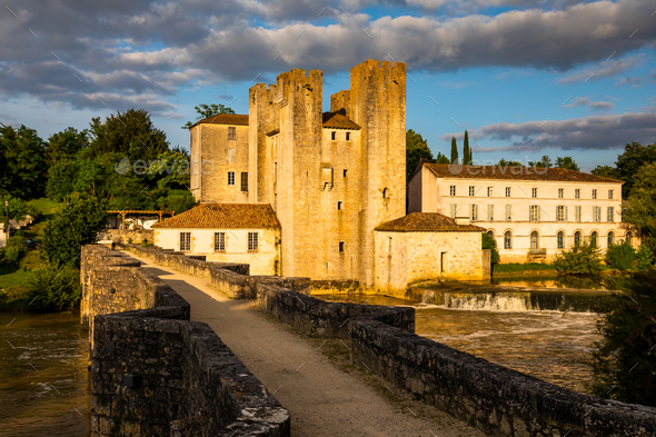 Moulin des Tours- fortified mill in Barbaste, France, at sunset - Stock Photo - Images