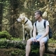 Tourist with dog in forest - PhotoDune Item for Sale
