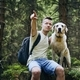 Hiker with dog in forest - PhotoDune Item for Sale