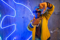 Black rapper in underpass neon light on background - PhotoDune Item for Sale