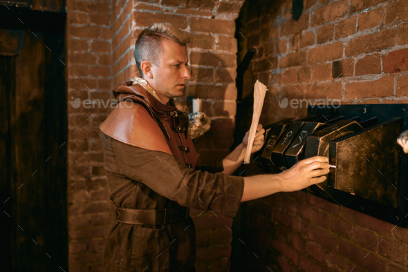 Ancient traveler draws labyrinth map on the door - Stock Photo - Images
