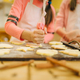 Girls cooks preparing to send cookies in the oven - PhotoDune Item for Sale