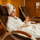 Sexy girl relaxing with cup of coffee in spa chair - PhotoDune Item for Sale