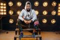 Black rapper in hoodie sitting on the steps - PhotoDune Item for Sale