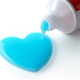 Toothpaste in the shape of heart coming out from toothpaste tube - PhotoDune Item for Sale