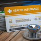 Health care medical Insurance card  and stethoscope as a symbol - PhotoDune Item for Sale
