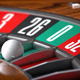Casino roulette wheel with sector zero and white ball. Closeup. - PhotoDune Item for Sale