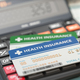 Medical insurance cards on the calculator. Health care costs con - PhotoDune Item for Sale