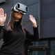 Woman Playing With Virtual Reality Glasses Against Futuristic Wall - PhotoDune Item for Sale