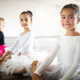 Group of fit happy children exercising ballet in studio together - PhotoDune Item for Sale