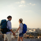 Multiethnic traveler couple using map together on sunny day - PhotoDune Item for Sale