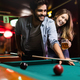 Young couple playing snooker together in bar - PhotoDune Item for Sale