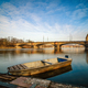 Sunrise view at Vltava river bridge and boat with clear water reflection. Prague Czech republic. - PhotoDune Item for Sale