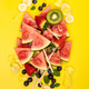 Slices of watermelon , fruits and berrieson yellow background - PhotoDune Item for Sale