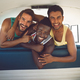 Front view of diverse male friends having fun in a camper van at beach - PhotoDune Item for Sale