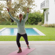 Determined active senior Caucasian woman doing yoga on exercise mat in the porch at home - PhotoDune Item for Sale