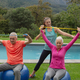 Caucasian female trainer assisting active senior Caucasian couple to exercise with resistance band  - PhotoDune Item for Sale
